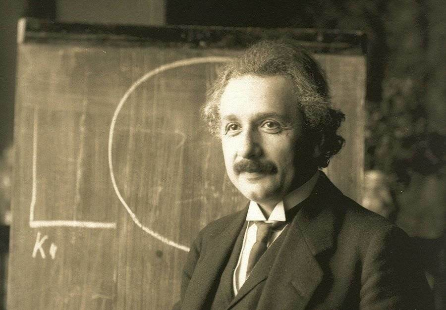 Albert Einstein; a famous lucid dreamer; pictured next to his work